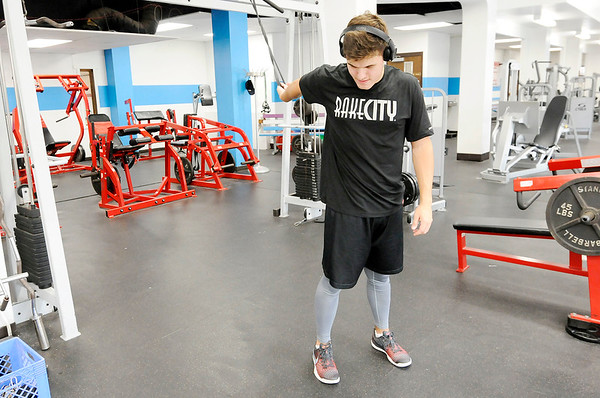 Don Knight | The Herald Bulletin<br /> Anderson University student Janson Anderson stretches while working out at the YMCA.