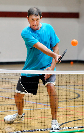 John P. Cleary | The Herald Bulletin<br /> Doug Bohall returns a shot while playing pickleball Wednesday afternoon at the Anderson YMCA.
