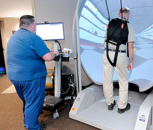 Don Knight | The Herald Bulletin<br /> Zach Whaley works with Richard Willowby on balance therapy at the Carl D. Erskine Rehabilitation Center on Tuesday.