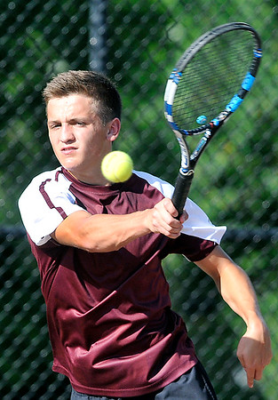 John P. Cleary   The Herald Bulletin<br /> Alexandria's no. 1 singles, Sam Hensley returns a forehand shot during his match Monday. Hensley won his match against Frankton's Andrew Harley after being honored on senior night for Alexandria tennis.