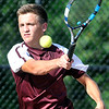 John P. Cleary | The Herald Bulletin<br /> Alexandria's no. 1 singles, Sam Hensley returns a forehand shot during his match Monday. Hensley won his match against Frankton's Andrew Harley after being honored on senior night for Alexandria tennis.