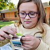 John P. Cleary | The Herald Bulletin<br /> Pendleton Elementary School fourth-grader Jocelyn Brown glues on her bead decorations to her native American bracelet she has made during Native American Celebration Day at the school.
