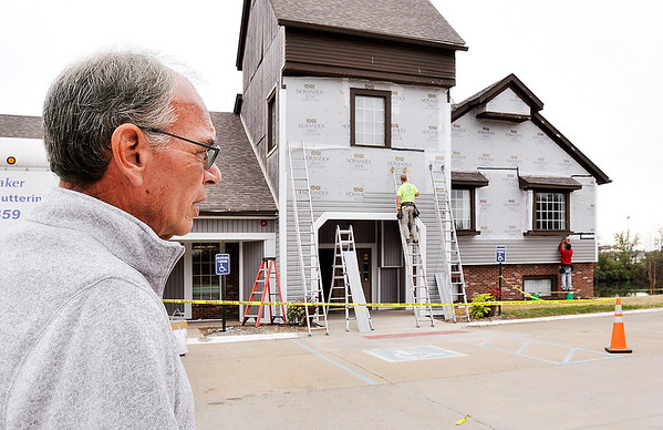 John P. Cleary | The Herald Bulletin<br /> Landing Office Park property manager looks over work being done to one of the buildings in the complex as the new owners have been refurbishing the facility.