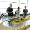 Don Knight | The Herald Bulletin<br /> From left, Alan Simpson, Curtis Corzine, Byvonda Hendrix and mark Nielsen race slot track cars at Purdue Polytechnic on Tuesday. The track was originally commissioned by Ford to mark the 50th anniversary of the Mustang and is a design inspired by Laguna Seca in California. The track is now owned by Tim Kern and kept at Purdue Polytechnic. Kern opens the track to the public every other Tuesday evening for racing. Kern would like to make the racing weekly if there is enough interest. You can find more information at the Facebook page Slot Racing Indy: Anderson.
