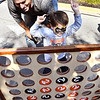 John P. Cleary | The Herald Bulletin<br /> Five-year old Simon Stull reacts as he wins the game Connect4 beating his dad, Steve Stull, during the Anderson University Homecoming Street Fair Saturday morning. Steve is a 2000 graduate of AU and lives in Anderson.