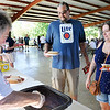 John P. Cleary | The Herald Bulletin<br /> Denny Cheshier dishes up coney sauce for Brandon and Farrah Hendrickson at the Madison County Solidarity Labor Council's annual Labor Day picnic.