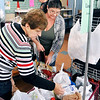 John P. Cleary | The Herald Bulletin<br /> Park Place Community Center Food Pantry volunteer Dorothy Hampton helps Lorie Hutson pick out items Monday during her visit to the food pantry.