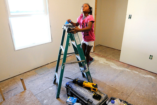 Don Knight | The Herald Bulletin<br /> Yanna Moore, 8, explores the room that will be hers at Habitat for Humanity's build site in Chesterfield on Thursday.