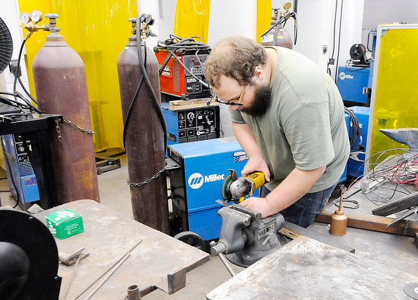 Don Knight | The Herald Bulletin<br /> Kameron Groce uses a cutoff wheel to trim a piece of metal at the Hinds Career Center on Tuesday.