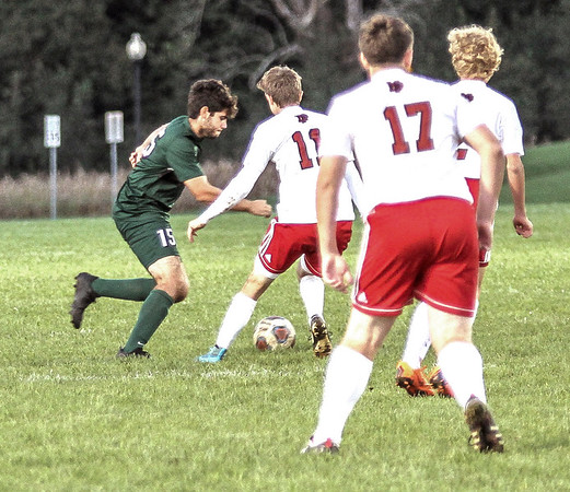 Photo by Chris Martin for The Herald Bulletin.<br /> Pendleton Midfielder Mason Fridley attempts to maneuver around New Paleistine's defense in a home match Thursday night.