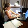 Don Knight | The Herald Bulletin<br /> Mary Kate Short, 9, works on an art assignment during an eLearning Day for ACS on Wednesday. ACS students have until the 17th to complete the assignments.