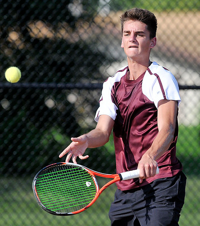 John P. Cleary | The Herald Bulletin<br /> Alexandria's no. 2 singles, Avery Paddock returns a shot during his match against Frankton's Brad Riser Monday. Paddock won the match.