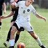 John P. Cleary | The Herald Bulletin<br /> Anderson University's Race Williams fights for control of the ball with UC Clermont's Cameron Smith.