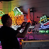 John P. Cleary | The Herald Bulletin<br /> Mercantile 37 co-founder J R Roudebush takes photos of some of the neon signs they have in their showroom.
