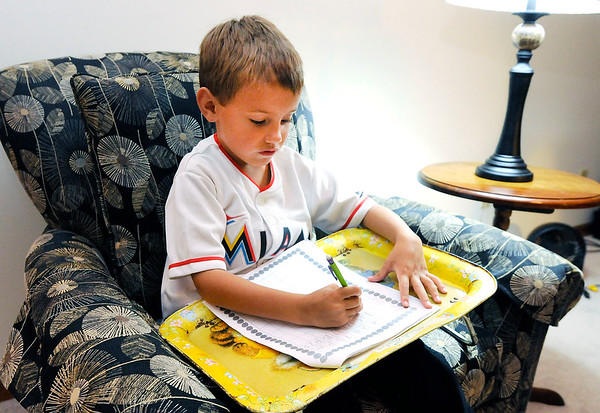 Don Knight | The Herald Bulletin<br /> First grader Matthew Short does a math work sheet, one of his eLearning Day assignments, on Wednesday. ACS staff spent the day on professional development.