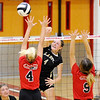 Don Knight | The Herald Bulletin<br /> Lapel's Zoe Freer attacks the ball as Frankton's Audrey Cleek (4) and Jaylen Lovett (9) attempt to block her on Wednesday.
