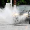 John P. Cleary | The Herald Bulletin<br /> An isolated thunderstorm dumped heavy rains over Anderson Thursday afternoon causing ponding water on many roadways like here along Brown-Delaware Street.