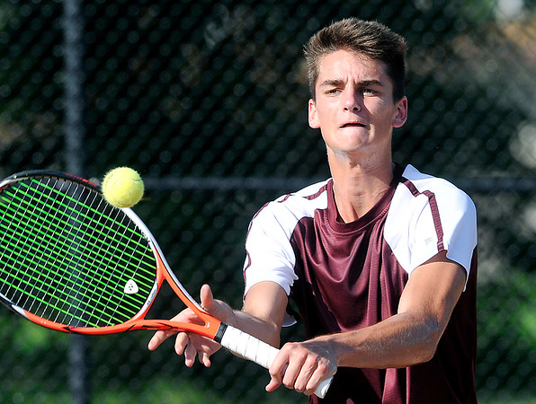 John P. Cleary | The Herald Bulletin<br /> Alexandria's no. 2 singles, Avery Paddock hits a short shot at the net during his match against Frankton's Brad Riser Monday. Paddock won the match.
