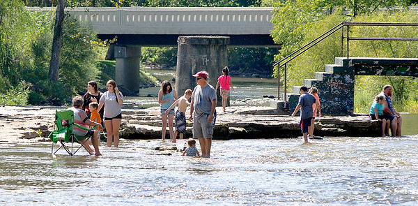 John P. Cleary   The Herald Bulletin<br /> A large number of people cooled off on a hot Labor Day holiday in the water at Falls Park in Pendleton.