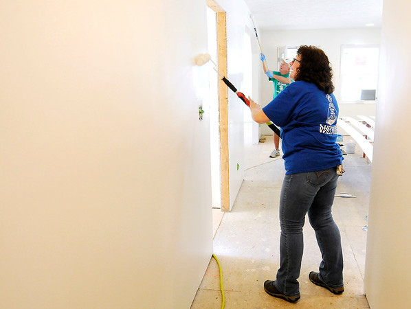 Don Knight | The Herald Bulletin<br /> Leigh Boram, foreground, and Karl Graddy paint the Habitat for Humanity home being built in Chesterfield on Thursday.