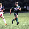 Photo by Chris Martin for The Herald Bulletin.<br /> Mason Fridley  runs past a New Palestine defender Thursday night at home.