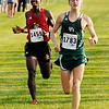 Don Knight | The Herald Bulletin<br /> Pendleton Heights' Sean Roan passes Liberty Christian's Negesse Kishpaugh to take third place at the Madison County meet at Pendleton Heights on Tuesday.