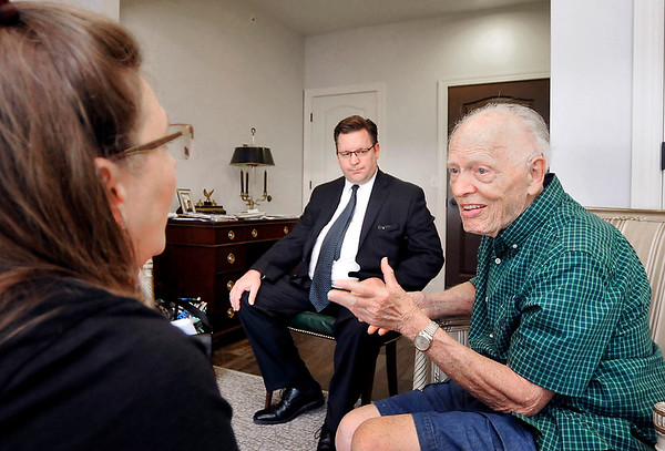 John P. Cleary | The Herald Bulletin<br /> Alzheimer's patient Sam Matthews, right, talks with Amber and John Longnaker during their visit with Sam in his apartment at Primrose Memory Care.