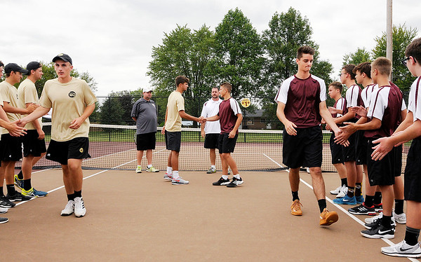 Don Knight | The Herald Bulletin<br /> Players are introduced as Alexandria hosted Madison-Grant for a tennis match on Wednesday. You can find the results in today's Sports section.