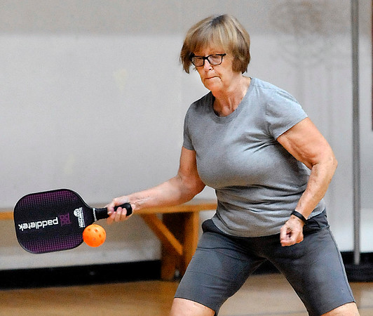 John P. Cleary | The Herald Bulletin<br /> Fair Anderson sets up to return a shot while playing pickleball Wednesday afternoon at the Anderson YMCA.