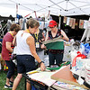 John P. Cleary | The Herald Bulletin<br /> Gaither Fall Festival goers check out some of the unique items offered by artisans at the vendor marketplace Friday during the annual festival.