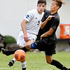 John P. Cleary | The Herald Bulletin<br /> Anderson University's Jacob Pokorski puts his kick on goal just under the outstretched leg of UC Clermont's Alex Strohofer to find a seam and score on the play.