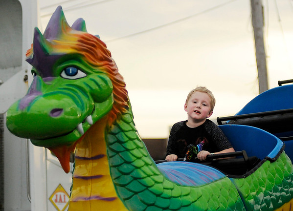 Don Knight | The Herald Bulletin<br /> Kolton O'Bryant rides a dragon roller coaster at Jessop Amusements at Mounds Mall. The carnival runs through Sunday. They will be open nightly from 6 to 10 p.m. with wristbands available for $20 and on Saturday and Sunday they will also be open from 1 to 5 p.m. with wristbands available for $15.
