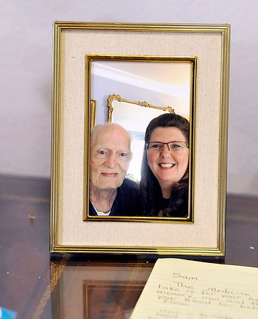 John P. Cleary | The Herald Bulletin<br /> A photo of Sam and Amber sit on the desk in Sam's apartment at Primrose Memory Care.