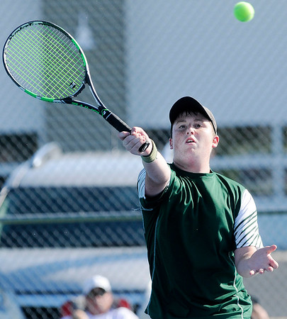 Don Knight | The Herald Bulletin<br /> Pendleton Heights' Kaleb Alumbaugh returns a volley to Lapel's Corbin Renihan in the No. 3 singles match at Lapel on Thursday.