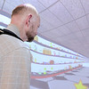 Don Knight | The Herald Bulletin<br /> Richard Willowby navigates a virtual grocery store aisle during balance therapy at the Carl D. Erskine Rehabilitation Center on Tuesday.