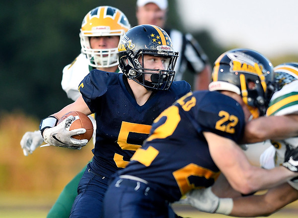 John P. Cleary   The Herald Bulletin<br /> Shenandoah's Dallas Pugsley cuts up field between blocks for a nice gain.