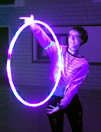 John P. Cleary | The Herald Bulletin<br /> Lydia Bakehorn, a hoop teacher from Fort Wayne, came to Anderson Preparatory Academy's  Music and Arts Festival with a friend and danced with her hoop to the music.