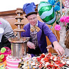 Don Knight | The Herald Bulletin<br /> Eric Scott served up strawberries stuffed with a cream cheese filling for dipping in a chocolate fountain during the sixth annual Community Chefs event hosted by Community Hospital Anderson on Saturday.
