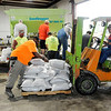 Don Knight | The Herald Bulletin<br /> County highway employees fill sandbags to be offered free of charge to Madison County residents on Friday. The remnants of Gordon are forecast to soak central Indiana over the weekend.