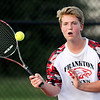 John P. Cleary | The Herald Bulletin<br /> Frankton's no. 2 singles Brad Riser returns a shot against Alexandria's Avery Paddock during their match Monday afternoon.