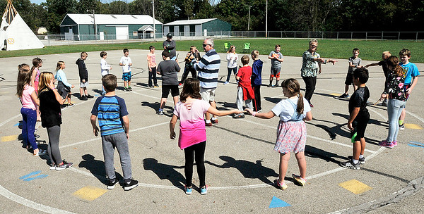John P. Cleary | The Herald Bulletin<br /> Native American children liked to play games like today's kids do so during Native American Celebration Day at Pendleton Elementary School the students  got to play the game Sticks & Bones, which is something like musical chairs only you stay still and pass sticks and bones to the beat of the drums.