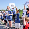 Don Knight | The Herald Bulletin<br /> Children hold up signs printed with the seven Corporal Works of Mercy during the Friends of the Poor Walk at Highland Middle School on Saturday.