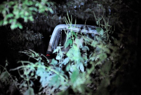 Don Knight | The Herald Bulletin<br /> AFD divers checked a Jeep found in the White River north of Louise Street on Tuesday evening. Nobody was inside. Divers will return to recover the vehicle during daylight hours on Wednesday.