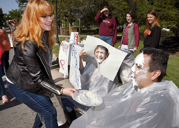 John P. Cleary | The Herald Bulletin<br /> 2012 AU graduate Brittnay Crowe, of Indianapolis, put a pie in the face of Tom Tijerina, director of Piece and Conflict Studies at AU, as Dr. Lolly Bargerstock, director Social Work programs, looks on after being pied by Brittnay earlier during the Anderson University Homecoming Street Fair. Pie-a-Prof was a fund raiser for the senior social work trip to San Francisco.