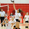 Don Knight | The Herald Bulletin<br /> Frankton's Chainey Lowe sends the ball over the net as the Eagles hosted the Alexandria Tigers on Tuesday.