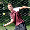 John P. Cleary | The Herald Bulletin<br /> Alexandria's no. 1 singles, Sam Hensley eyes a forehand shot during his match Monday. Hensley won his match against Frankton's Andrew Harley after being honored on senior night for Alexandria tennis.