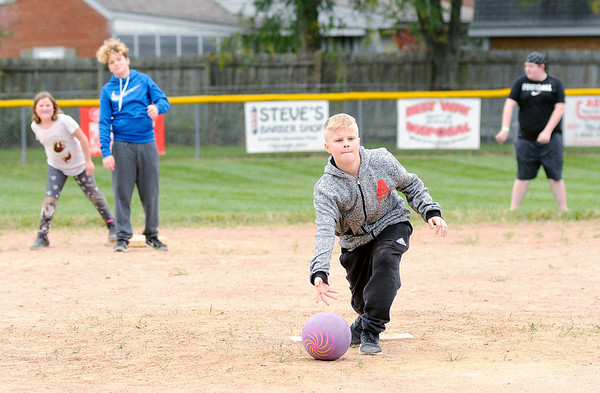 Don Knight | The Herald Bulletin<br /> Jaxon Milburn pitches in a pickup kick ball game during the Brooklyn Proud Bash at Erskine Park on Saturday. The game was part of a day long fundraiser to help the Brooklyn Little League recoup losses after being burglarized at least twice in August.