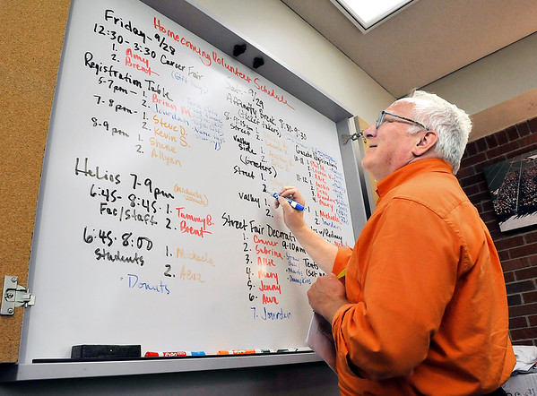 John P. Cleary   The Herald Bulletin<br /> Scott Tilley, Alumni Director for Anderson University, goes over his homecoming volunteer schedule for the upcoming weekend.
