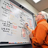 John P. Cleary | The Herald Bulletin<br /> Scott Tilley, Alumni Director for Anderson University, goes over his homecoming volunteer schedule for the upcoming weekend.