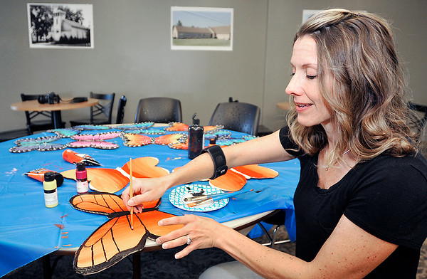 John P. Cleary | The Herald Bulletin<br /> Pastor Kristine Marshall, of Bethel United Methodist Church, paints butterflies for an outreach project that gives the colorfull cardboard butterflies to people that are struggling with issues like cancer, divorce, depression, loss of a loved one.